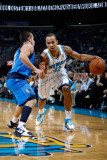 Dallas Mavericks v New Orleans Hornets: Jerryd Bayless and Jose Barea Lmina fotogrfica por Chris Graythen