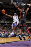Miami Heat v Sacramento Kings: Tyreke Evans and Chris Bosh Photographic Print by Rocky Widner