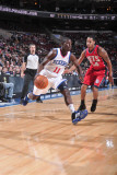 New Jersey Nets v Philadelphia 76ers: Jrue Holiday and Devin Harris Photographic Print by David Dow
