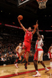 Houston Rockets v Toronto Raptors: Luis Scola and Reggie Evans Photographic Print by Ron Turenne