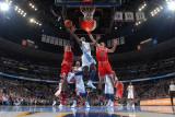 Chicago Bulls v Denver Nuggets: Ty Lawson and Joakim Noah Photographic Print by Garrett Ellwood