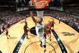 Cleveland Cavaliers v San Antonio Spurs: Tim Duncan and Jamario Moon Photographic Print by D. Clarke Evans