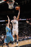 New Orleans Hornets v San Antonio Spurs: Tiago Splitter and Jason Smith Photographic Print by D. Clarke Evans