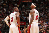 Charlotte Bobcats v Miami Heat: LeBron James and Dwyane Wade Photographic Print by Victor Baldizon