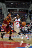 Cleveland Cavaliers v Detroit Pistons: Rodney Stuckey and Mo Williams Photographic Print by Allen Einstein