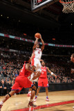 Philadelphia 76ers v Toronto Raptors: DeMar DeRozan and Evan Turner Photographic Print by Ron Turenne