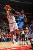 Oklahoma City Thunder v Chicago Bulls: Carlos Boozer and Serge Ibaka Photographic Print by Joe Murphy