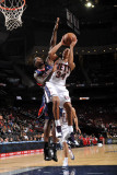 Atlanta Hawks v New Jersey Nets: Devin Harris and Marvin Williams Photographic Print by Jesse D. Garrabrant
