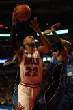 Orlando Magic v Chicago Bulls: Taj Gibson and Vince Carter Photographic Print by Jonathan Daniel