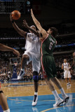Milwaukee Bucks v Dallas Mavericks: Brendan Haywood and Andrew Bogut Photographic Print by Danny Bollinger