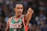 Milwaukee Bucks v Denver Nuggets: Brandon Jennings Photographic Print by Garrett Ellwood