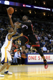 Miami Heat v Golden State Warriors: Dwayne Wade and Monta Ellis Photographic Print by  Ezra