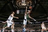 Milwaukee Bucks v Dallas Mavericks: Brandon Jennings and Dirk Nowitzki Photographic Print by Glenn James