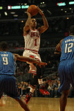 Orlando Magic v Chicago Bulls: Derrick Rose, Rashard Lewis and Dwight Howard Photographic Print by Jonathan Daniel