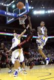 Miami Heat v Golden State Warriors: Dwayne Wade and Monta Ellis Photographic Print by  Ezra