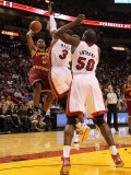 Cleveland Cavaliers  v Miami Heat: Ramon Sessions, Joel Anthony and Dwyane Wade Photographic Print by Mike Ehrmann