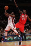 New Jersey Nets v New York Knicks: Raymond Felton and Johan Petro Photographic Print by Nick Laham