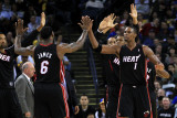 Miami Heat v Golden State Warriors: Lebron James and Chris Bosh Photographic Print by  Ezra