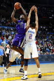 Sacramento Kings v Oklahoma City Thunder: Thabo Sefolosha and Tyreke Evans Photographic Print by Larry W. Smith