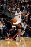 Miami Heat v Washington Wizards: LeBron James and Josh Howard Photographic Print by Greg Fiume