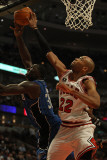 Orlando Magic v Chicago Bulls: Taj Gibson and Brandon Bass Photographic Print by Jonathan Daniel