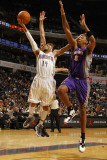 Phoenix Suns v Charlotte Bobcats: D.J. Augustin and Channing Frye Photographic Print by Kent Smith