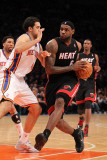 Miami Heat v New York Knicks: LeBron James and Danilo Gallinari Photographic Print by Al Bello