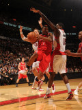 Houston Rockets v Toronto Raptors: Kyle Lowry and Amir Johnson Photographic Print by Ron Turenne