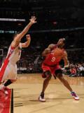 Philadelphia 76ers v Toronto Raptors: Andre Iguodala and Linas Kleiza Photographic Print by Ron Turenne