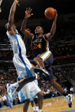 Utah Jazz v New Orleans Hornets: Paul Millsap and Emeka Okafor Photographic Print by Layne Murdoch