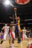 Los Angeles Lakers v Toronto Raptors: Andrew Bynum and Joey Dorsey Photographic Print by Ron Turenne