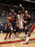 Chicago Bulls v Toronto Raptors: Luol Deng, Ed Davis and Carlos Boozer Photographic Print by Ron Turenne