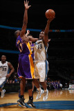 Los Angeles Lakers v Washington Wizards: Kevin Seraphin and Andrew Bynum Photographic Print by  Ned