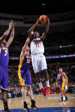 Los Angeles Lakers v Philadelphia 76ers: Jrue Holiday and Lamar Odom Photographic Print by Jesse D. Garrabrant