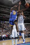 Golden State Warriors v Dallas Mavericks: Reggie Williams and Alexis Ajinca Photographic Print by Glenn James