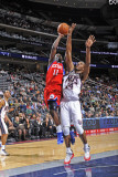 Philadelphia 76ers v New Jersey Nets: Jrue Holiday and Derrick Favors Photographic Print by David Dow