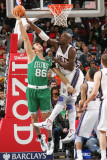 Boston Celtics v New Jersey Nets: Semih Erden and Johan Petro Photographic Print by Jeyhoun Allebaugh