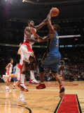 Washington Wizards v Toronto Raptors: Amir Johnson and Gilbert Arenas Photographic Print by Ron Turenne