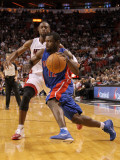 Detroit Pistons v Miami Heat: Will Bynum and Dwyane Wade Photographic Print by Mike Ehrmann
