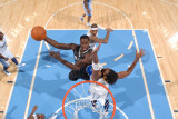 Orlando Magic v Denver Nuggets: Brandon Bass and Nene Photographic Print by Garrett Ellwood