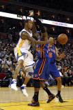 New York Knicks v Golden State Warriors: Monta Ellis and Ronny Turiaf Photographic Print by Ezra Shaw