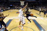 Denver Nuggets v Charlotte Bobcats: Ty Lawson and Boris Diaw Photographic Print by  Streeter