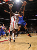 New York Knicks v Toronto Raptors: Wilson Chandler and Amir Johnson Photographic Print by Ron Turenne