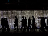 Pedestrians Walk in Front of a Light Display in Las Vegas Photographic Print by Jodi Cobb
