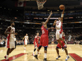 Philadelphia 76ers v Toronto Raptors: Leandro Barbosa and Marreese Speights Photographic Print by Ron Turenne