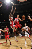 New Jersey Nets v Toronto Raptors: Devin Harris and Amir Johnson Photographic Print by Ron Turenne