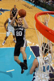 San Antonio Spurs v New Orleans Hornets: Manu Ginobili and Jason Smith Photographic Print by Chris Graythen