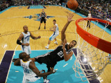 San Antonio Spurs v New Orleans Hornets: Tim Duncan and Emeka Okafor Photographic Print by Chris Graythen