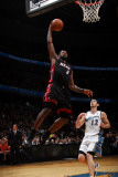 Miami Heat v Washington Wizards: LeBron James and Kirk Hinrich Photographic Print by Ned Dishman