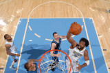 Minnesota Timberwolves v Denver Nuggets: Nene and Kevin Love Photographic Print by Garrett Ellwood